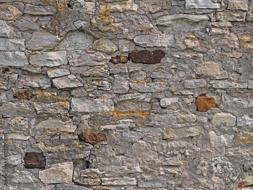 Old brick stone wall background, rural mediterranean stonewall