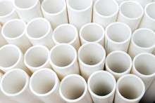White PVC Pipes Stacked On A P...