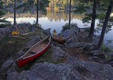 Canoes On The Shore Of A Lake In Algonquin Provincial Park, Ontario, Canada..