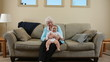 Elderly Great Grandmother sitting with baby