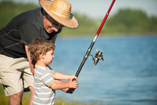 Little Boy Fishing With Grandpa