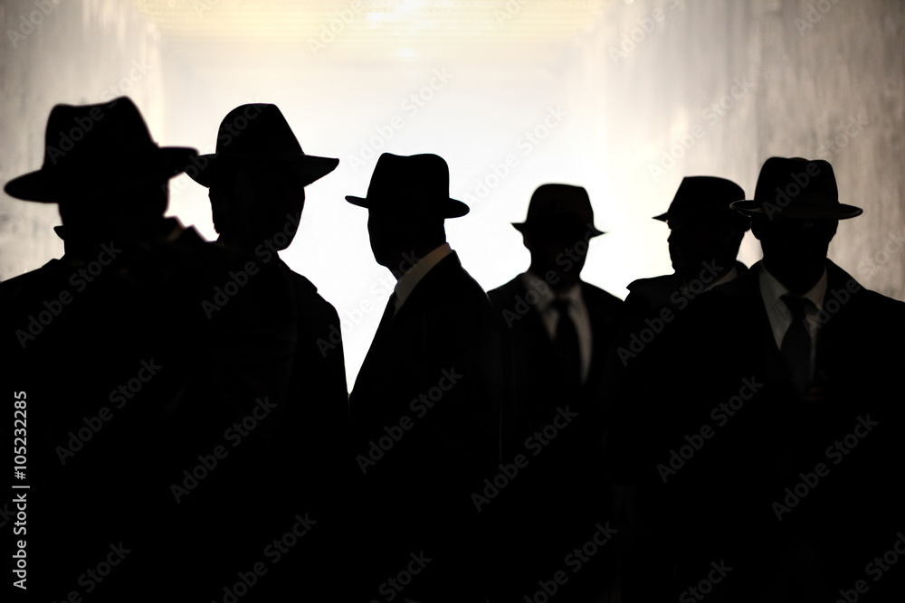 Fototapeta Men in fedora hats silhouette. Security, Privacy, Surveillance Concept.
