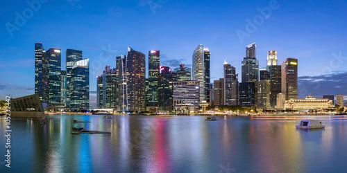 Keuken foto achterwand Verenigde Staten Colorful Singapore business district skyline after sun set at Marina Bay. Panoramic image.