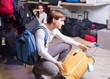 couple choosing travel suitcase