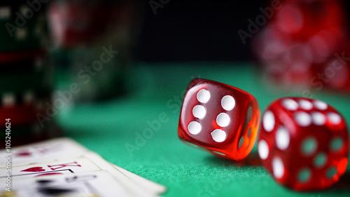 Red dice, casino chips, cards on green felt Wallpaper Mural