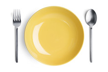 A Yellow Plate With Silver For...
