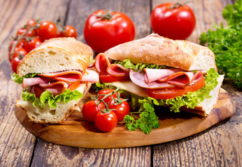 Fototapetatwo sandwiches with ham and vegetables