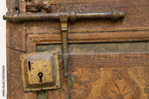 door and lock in the 19th century Bahia Palace in Marrakech Poster