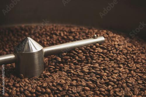 Fotografija beans freshly baked  hot inside roasting machine closeup