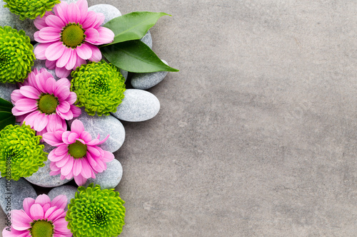 Spa stones and flowers on grey background. Plakat