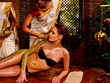 Young woman having body Ayurveda spa massage. Healing massage.