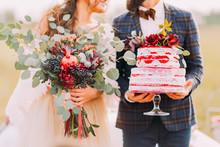 Wedding Couple Holds Beautiful...
