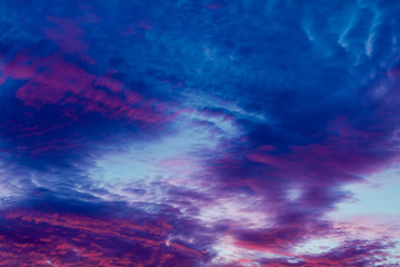 Colorful vibrant clouds on sky at sunset