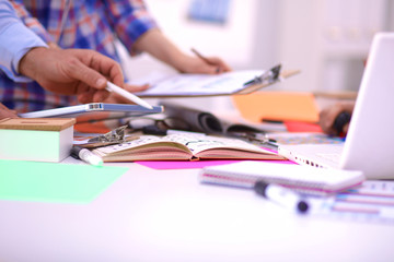 Close-up of three young creative designers working on project together. Team work