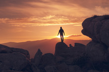 Man Silhouette On The Summit At Sunset