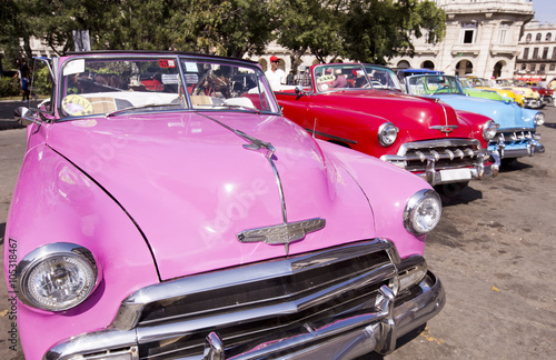 Old american cars are waiting for the tourists in Havana Canvas Print