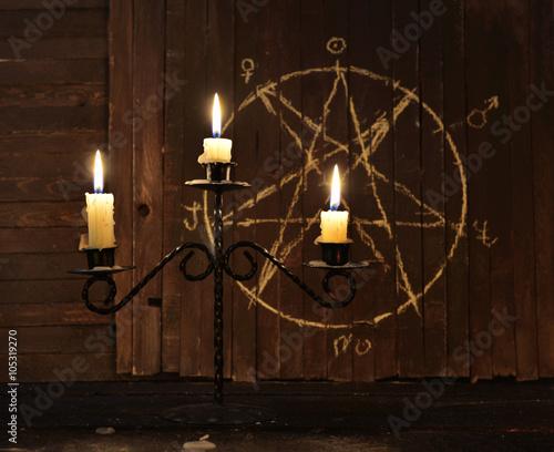 Fotografie, Obraz  Candelabrum against background with pentagram
