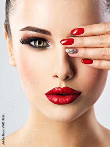 beautiful woman with bright fashion make-up and red nails Poster