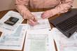 Filling 1040 tax form wtih laptop