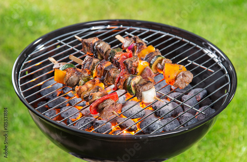 Photo Stands Grill / Barbecue Barbecue grill with tasty skewers.