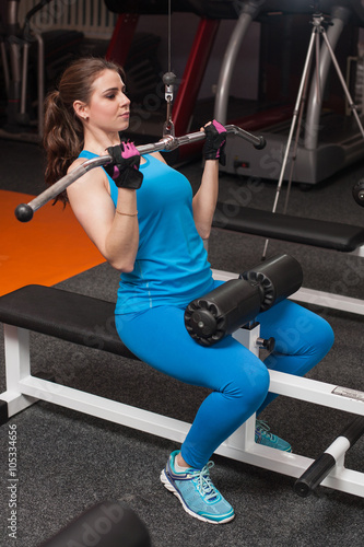 woman at the gym exercising on a machine Canvas-taulu