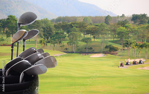 Photo  Golf clubs drivers over green field background