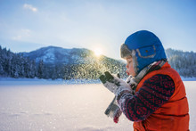 Boy Blowing Snow