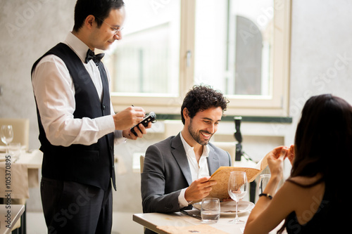 waiter taking orders in a restaurant buy this stock photo and