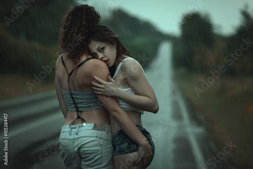 Fotografía  Two women in a passionate embrace.