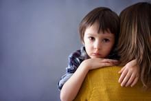 Sad Little Child, Boy, Hugging His Mother At Home