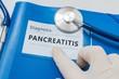 Pancreatitis diagnosis on blue folder with stethoscope.