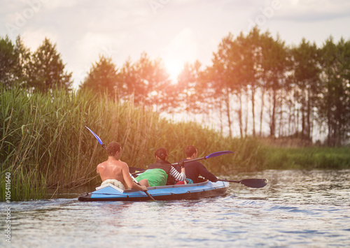 Young people are kayaking on a river in beautiful nature Canvas-taulu