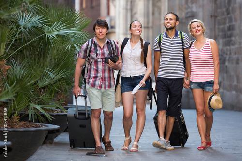 Positive tourists watching landmark