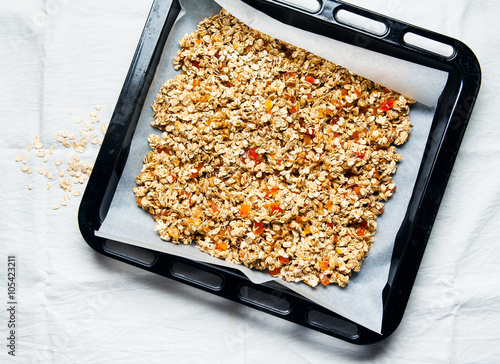 Valokuva  preparation of granola. on a baking sheet for oven