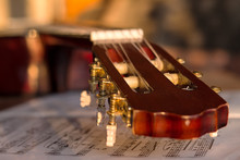 Guitar Headstock On Music Notes, Close Up