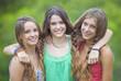 Leinwandbild Motiv happy smiling teenage girls with white teeth