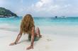 Beautiful woman lying on white sand beach
