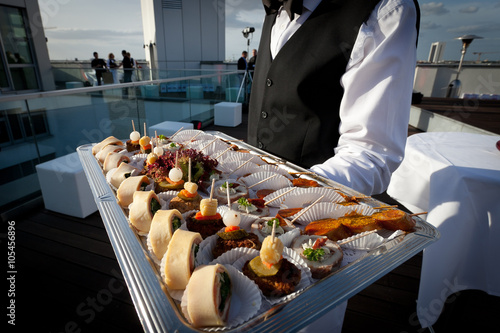 Stampa su Tela waiter is offering a flying food buffet
