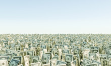 Heap Of Banknote Dollar Bills Grass On The Background Blue Sky