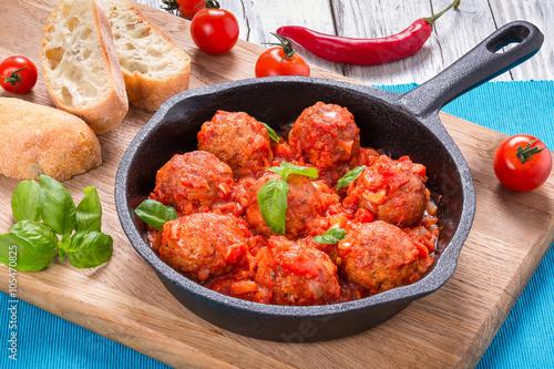 fototapeta na lodówkę homemade meatballs smothered in a marinara tomato sauce with bas