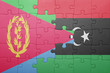 canvas print picture - puzzle with the national flag of eritrea and libya