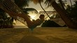 Young lady lying in hammock, enjoying tropical vacation in paradise at beautiful golden sunset