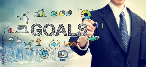 Photo  Businessman drawing Goals concept