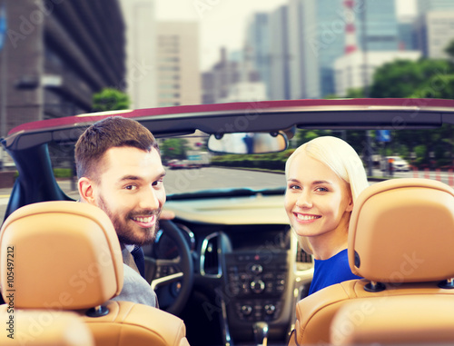 Keuken foto achterwand Vintage cars happy couple driving in cabriolet car over city