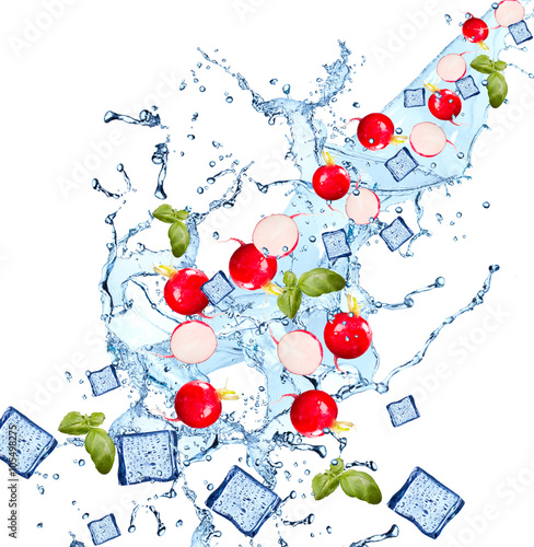Keuken foto achterwand Opspattend water Water splash with vegetable isolated on white backgroud. Fresh radish