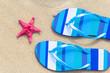 Top view beach flip flops sand