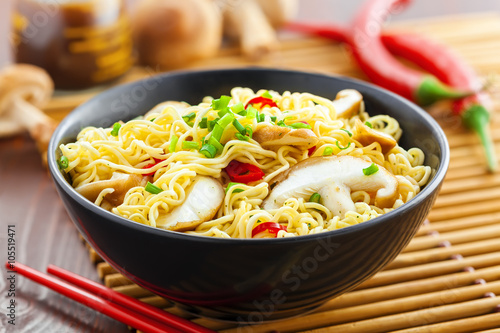 Traditional Asian instant noodles meal with shiitake mushrooms and vegetables