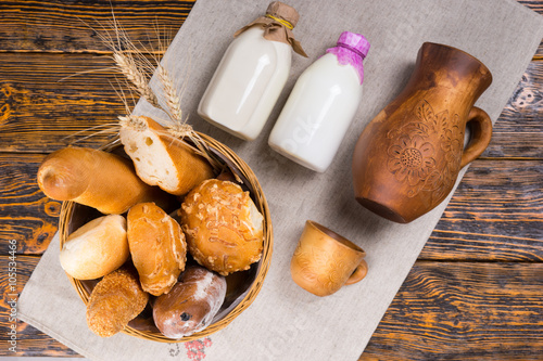 Poster Picnic Top down view of bread basket and milk