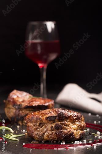 Obraz na plátne  Grilled steak meat (mignon) on the dark surface