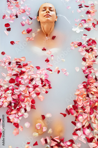 0279debb079c0 Spa Relax In Flower Bath. Woman Health And Beauty. Closeup Beautiful Sexy Girl  Bathing With Rose Petals In Renew Day Spa Salon.